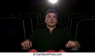 boy sitting at cinema, Close up - boy sitting on armchairs...