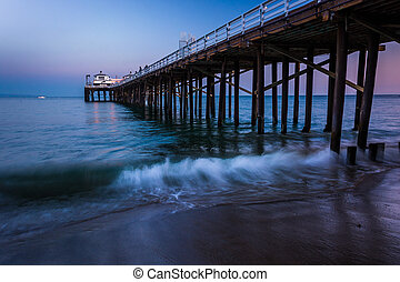The Malibu Pier at twilight, in Malibu, California.