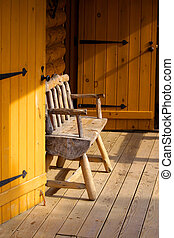 Log cabin portico - Single bench in the log cabin portico
