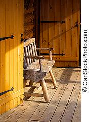 Log cabin portico - Single bench in the log cabin portico