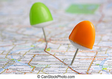 Push pins - Orange and green push pins on the map