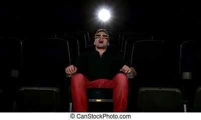 man watching movie alone in empty theater auditorium, 3D...