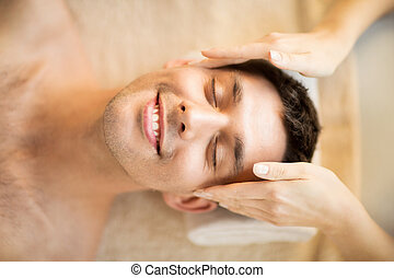 man in spa - close up of man face in spa salon getting...