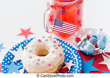 donut with juice and candies on independence day - american...
