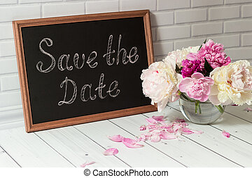 Invitation with bouquet of peonies and chalkboard -...