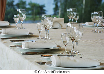 table appointments in restaurant knifes forks wineglasses