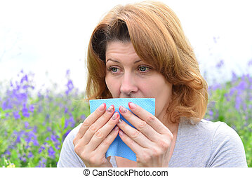 adult woman with allergies on the Meadow - An adult woman...