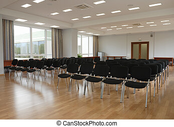 auditorium - bright conference hall, black chairs, window,...