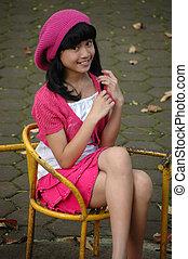 cute girl sit down in park - cute asian girl sit down in...