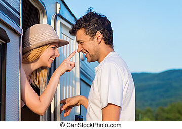 Young couple with a camper van - Beautiful young couple in...