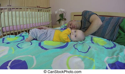tired father sleep baby - Tired father man wake up and care...