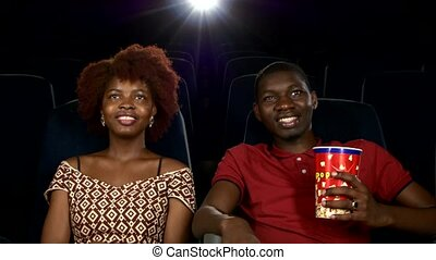 Happy African American couple, watching movie In theatre, Close up