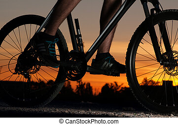 Silhouette of a cyclist at sunset.