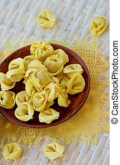 Meat Cappelletti - Raw Meat Cappelletti on Brown Plate with...