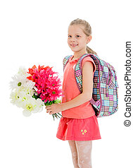 Girl schoolgirl with a bouquet of flowers