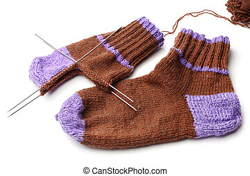 Wool knitted socks on white background