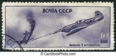 USSR - 1945: shows Iakovlev Fighter Yak-9 in action, series...