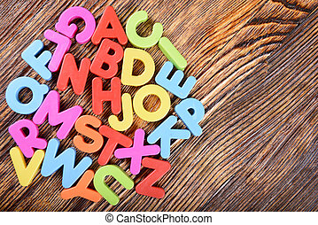 Plastic alphabet letters - composition of colorful plastic...