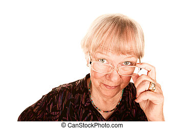 Senior woman looking over her glasses - Senior woman looking...