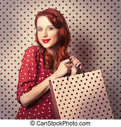 redhead girl with shopping bags - Portrait of a redhead girl...