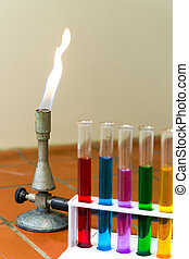 Gas burner with colored test tubes - Flaming gas burner with...