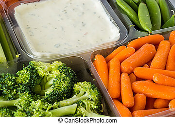 Vegetable tray with dip. - Closeup of vegetable tray with...