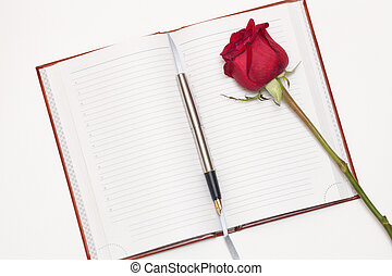 Diary book - Open diary book, pen and rose on a white