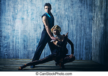 latin american dance - Two beautiful dancers perform the...