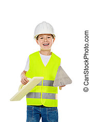working tools - A boy in a costume of a builder posing with...