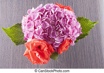 Geranium and roses seen from above, horizontal image