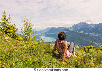 a woman looking at the mountain