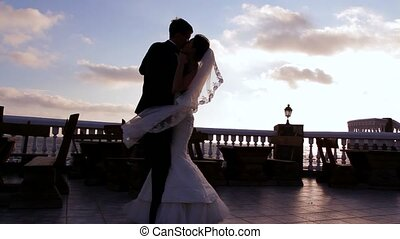 Newlyweds Dancing - Newlyweds dancing on a quay. Two frames