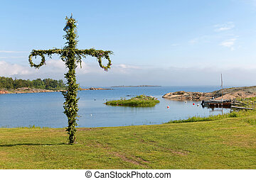 Maypole and the swedish archipelago in the background -...