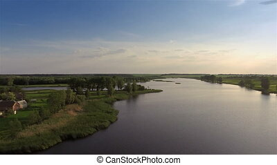 Flying over the river - Aerial shot: Flying over river and...