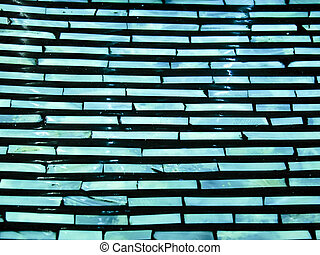 Section of a ceramic tray - Close up of a green and blue...