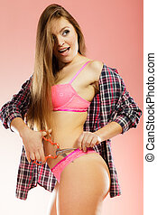 Girl taking off panties, cutting her lingerie with scissors