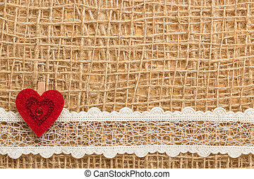 Red heart on abstract cloth background - Valentines day or...