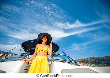 Woman relaxing on the yacht - Young and pretty woman in...