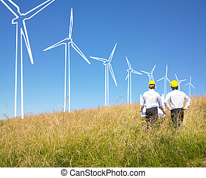 Engineers building windmills - Engineers in field with plans...