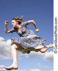 Woman Running in Dress - Woman running with sky as...