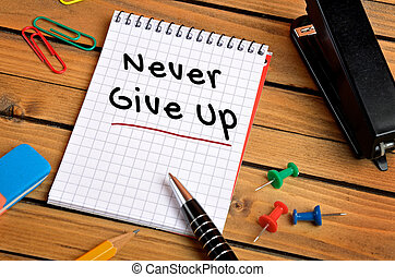 Never give up word on notebook