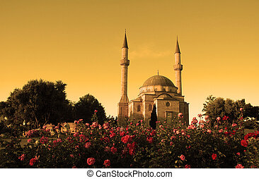 Mosque with two minarets in Baku, Azerbaijan at sunset