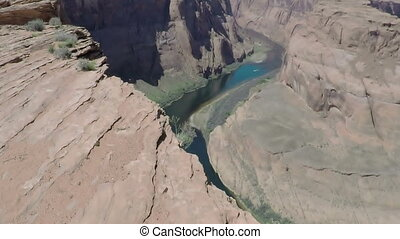 Horse Shoe Canyon - Boat traveling down river in Horse Shoe...
