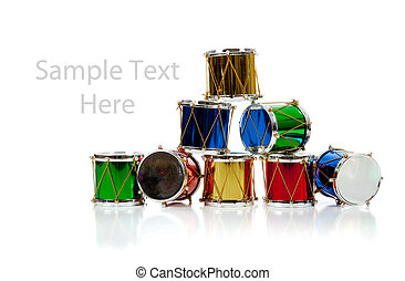 Miniature Christmas drums on white with copy space -...