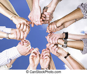 Clasped Hands in a Circle - Circle of peoples arms, holding...