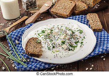 Homemade yogurt dip with blue cheese and chives, whole wheat...