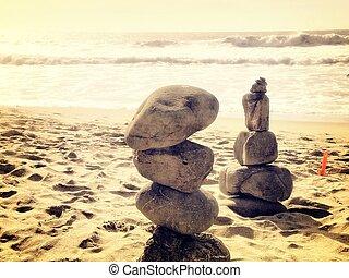 balancing stone at the beach