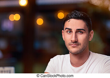 Surprised Young Man in a Restaurant