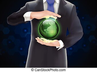 Hands holding earth with green