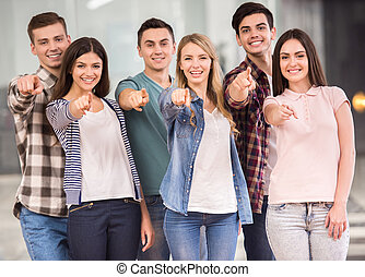 Group interaction - Successful team. Group of cheerful young...